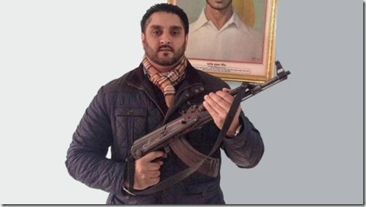 Ajit Atwal and AK-47 pose
